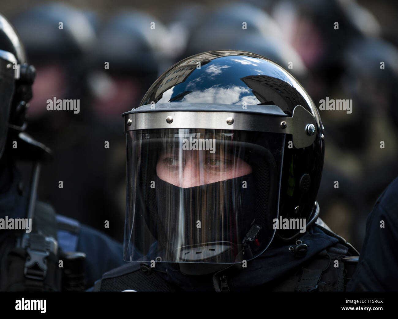 Kyiv, Kyiv Oblast, Ukraine. 23rd Mar, 2019. A Ukrainian police officer in riot gear seen standing guard during the demonstration. Protesters gathered in Maidan Square then marched to the Presidential Administration building to call on President Petro Poroshenko to bring corrupt governmental officials to justice. With the Ukrainian Elections being held at the end of March the political tensions run very high. Credit: Matthew Hatcher/SOPA Images/ZUMA Wire/Alamy Live News Stock Photo