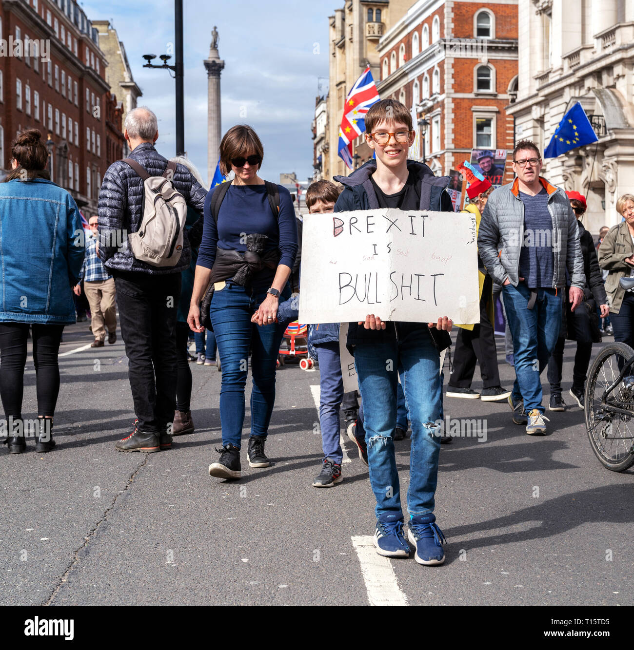 """London, UK. 23rd Mar 2019. A Young protestor holds the banner """"Brexit is Bullshit"""" during the People's Vote march in London. Credit: AndKa/Alamy Live News Stock Photo"""