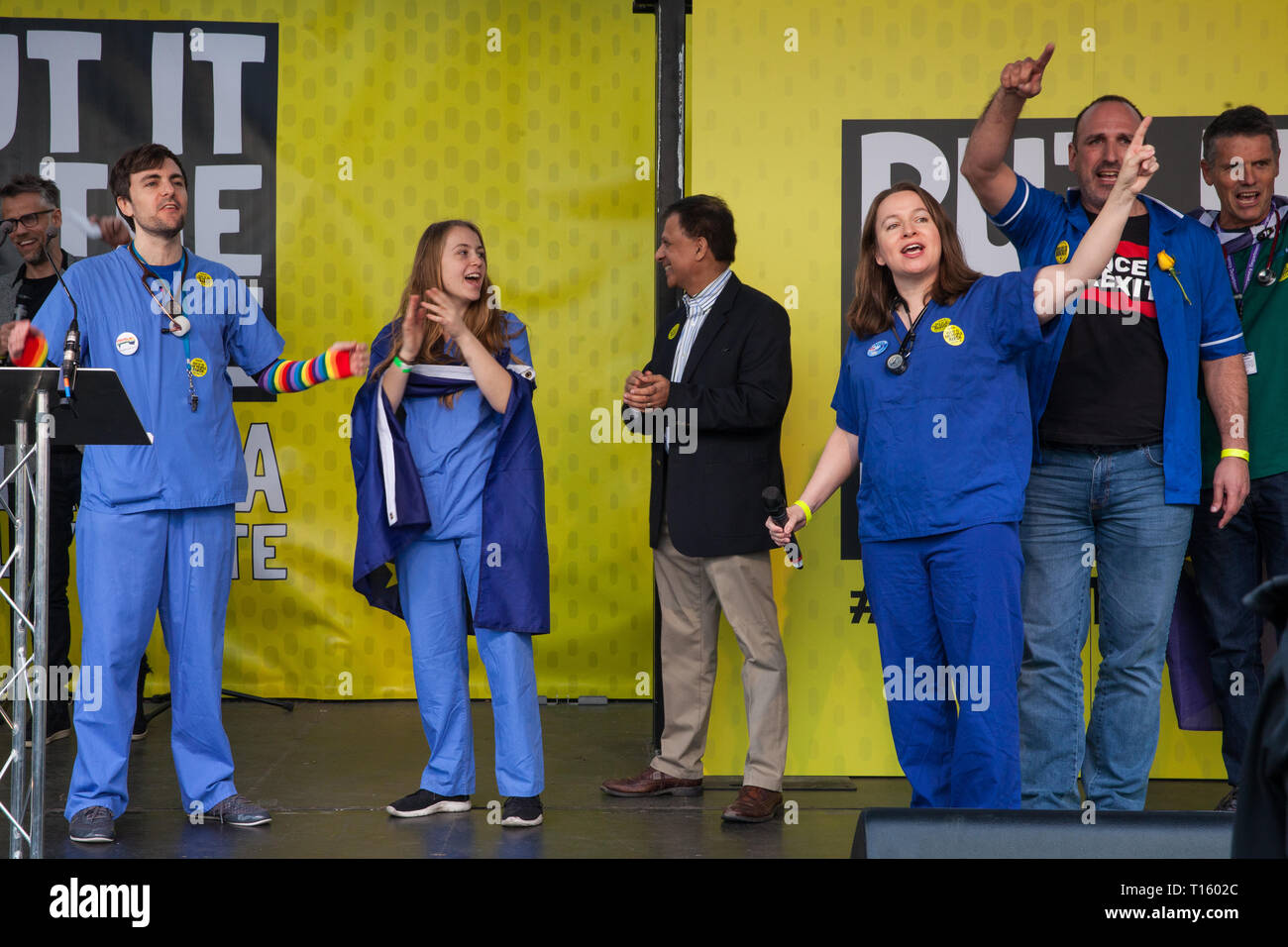London, UK. 23rd March, 2019. National Health Service workers wave to the crowd after addressing a million people taking part in a People's Vote rally in Parliament Square following a march from Park Lane. Credit: Mark Kerrison/Alamy Live News - Stock Image