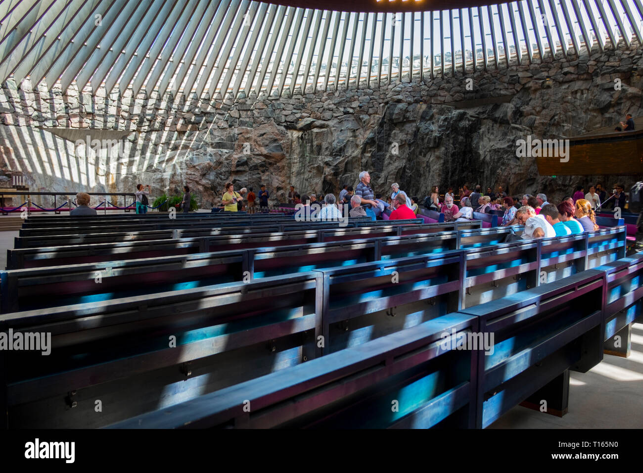 Interior view of the partially underground, rock-carved Temppeliaukio church in Helsinki, Finland. The Lutheran church has a natural appearance. Stock Photo