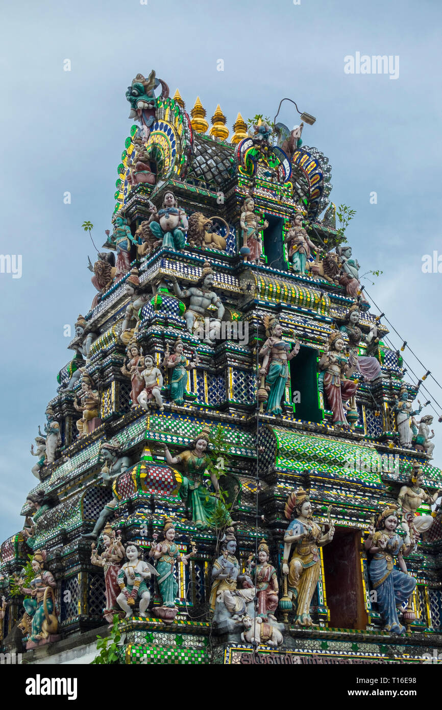 The unique Arulmigu Sri Rajakaliamman Glass Temple in Johor Bahru, Malaysia. The interior is completely covered in glass tiles. Gopuram tower. - Stock Image