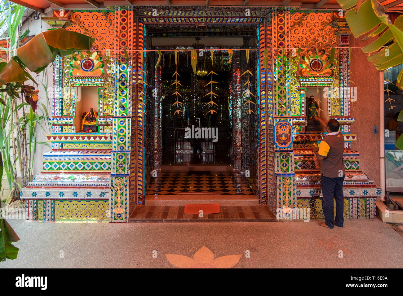The unique Arulmigu Sri Rajakaliamman Glass Temple in Johor Bahru, Malaysia. The interior is completely covered in glass tiles. Front entrance. - Stock Image