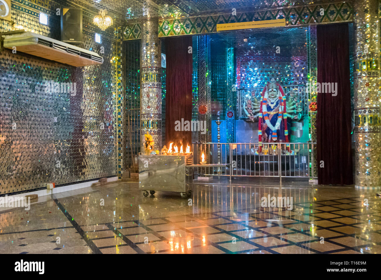 The unique Arulmigu Sri Rajakaliamman Glass Temple in Johor Bahru, Malaysia. The interior is completely covered in glass tiles. Glittery interior. - Stock Image