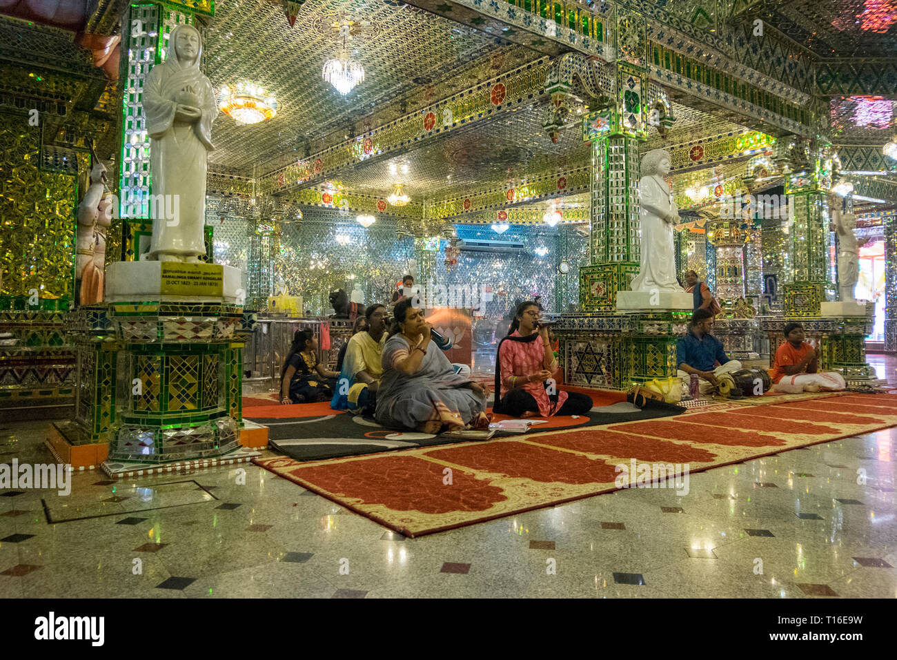 The unique Arulmigu Sri Rajakaliamman Glass Temple in Johor Bahru, Malaysia. The interior is completely covered in glass tiles. Singing. - Stock Image