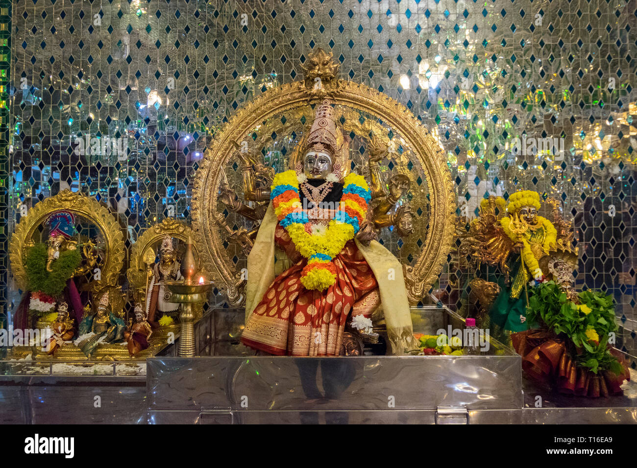 The unique Arulmigu Sri Rajakaliamman Glass Temple in Johor Bahru, Malaysia. The interior is completely covered in glass tiles. Icon detail. - Stock Image