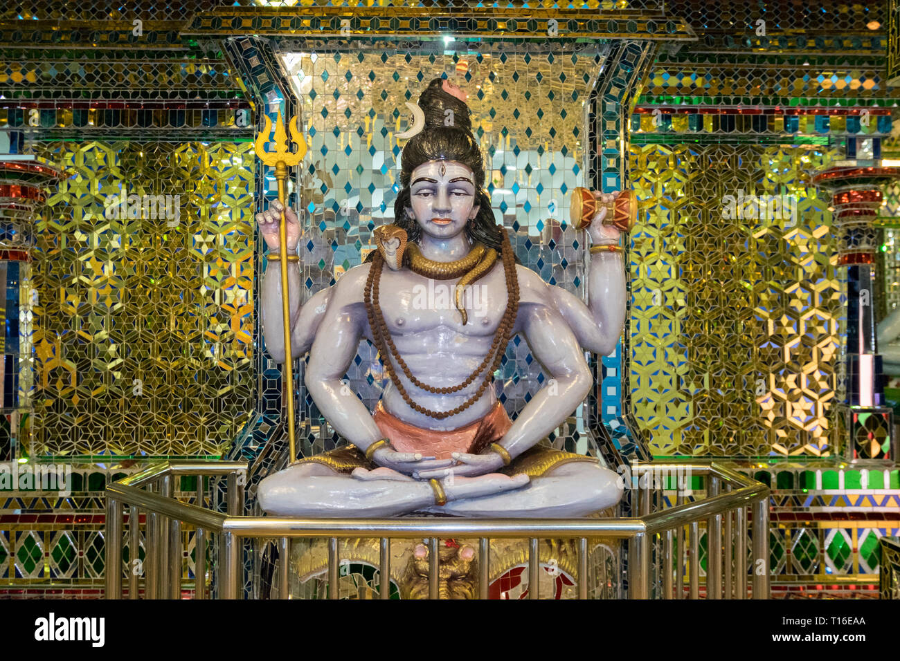 The unique Arulmigu Sri Rajakaliamman Glass Temple in Johor Bahru, Malaysia. The interior is completely covered in glass tiles. Two headed man detail. - Stock Image