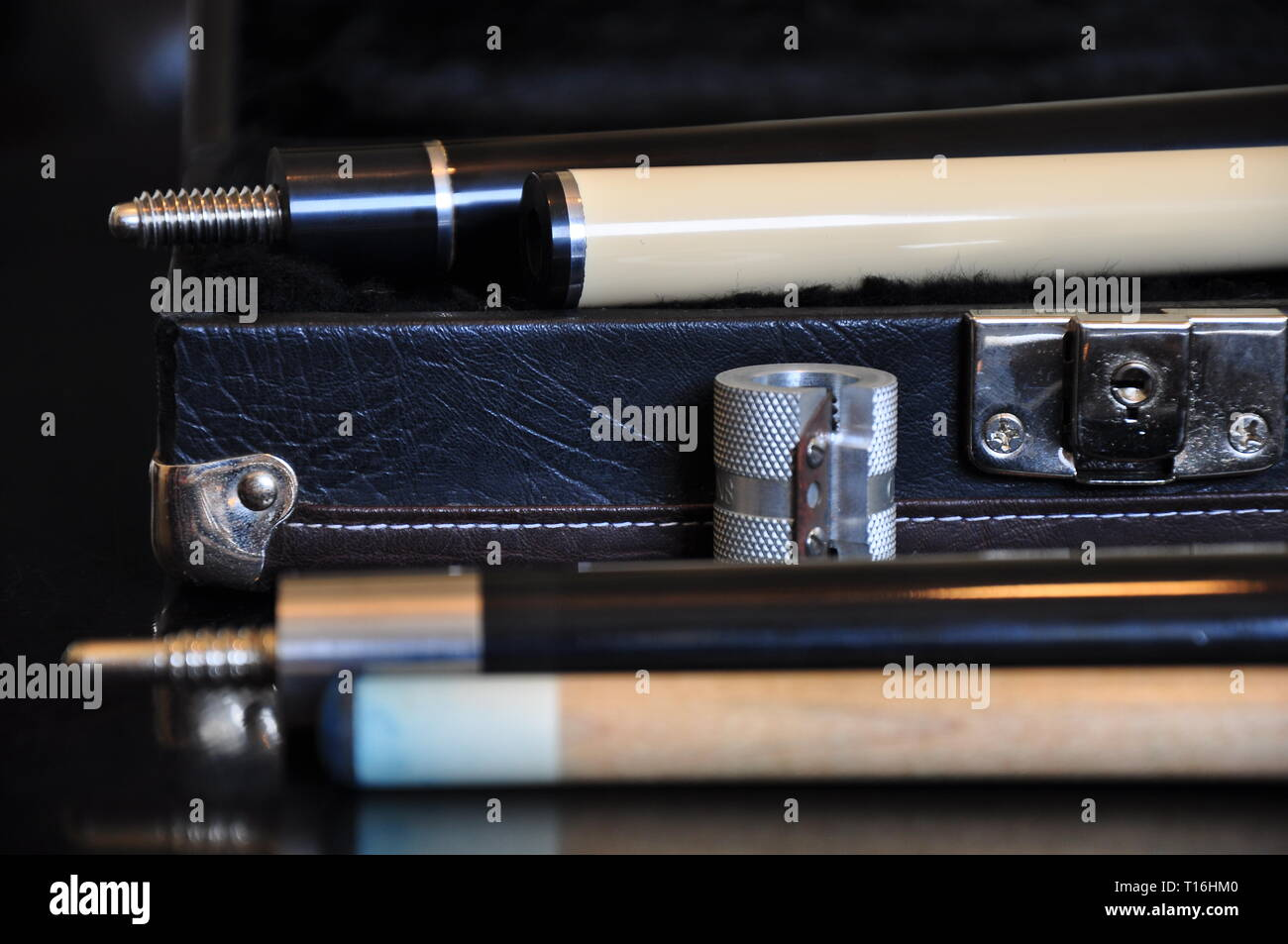 Open trunk cue case and the cues for the game of pool. - Stock Image