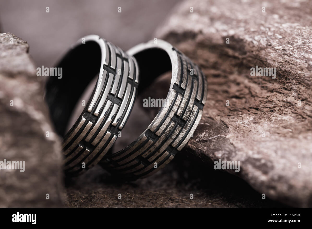 Silver mens rings on the stones, close-up - Stock Image