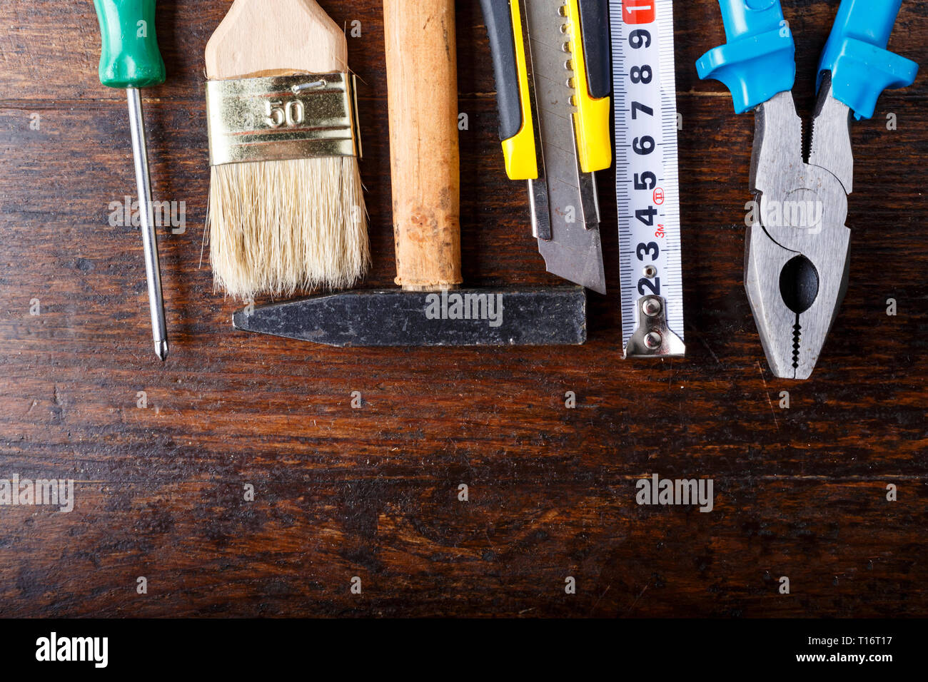 work tool set. on a brown wooden table. view from above. space for text - Stock Image