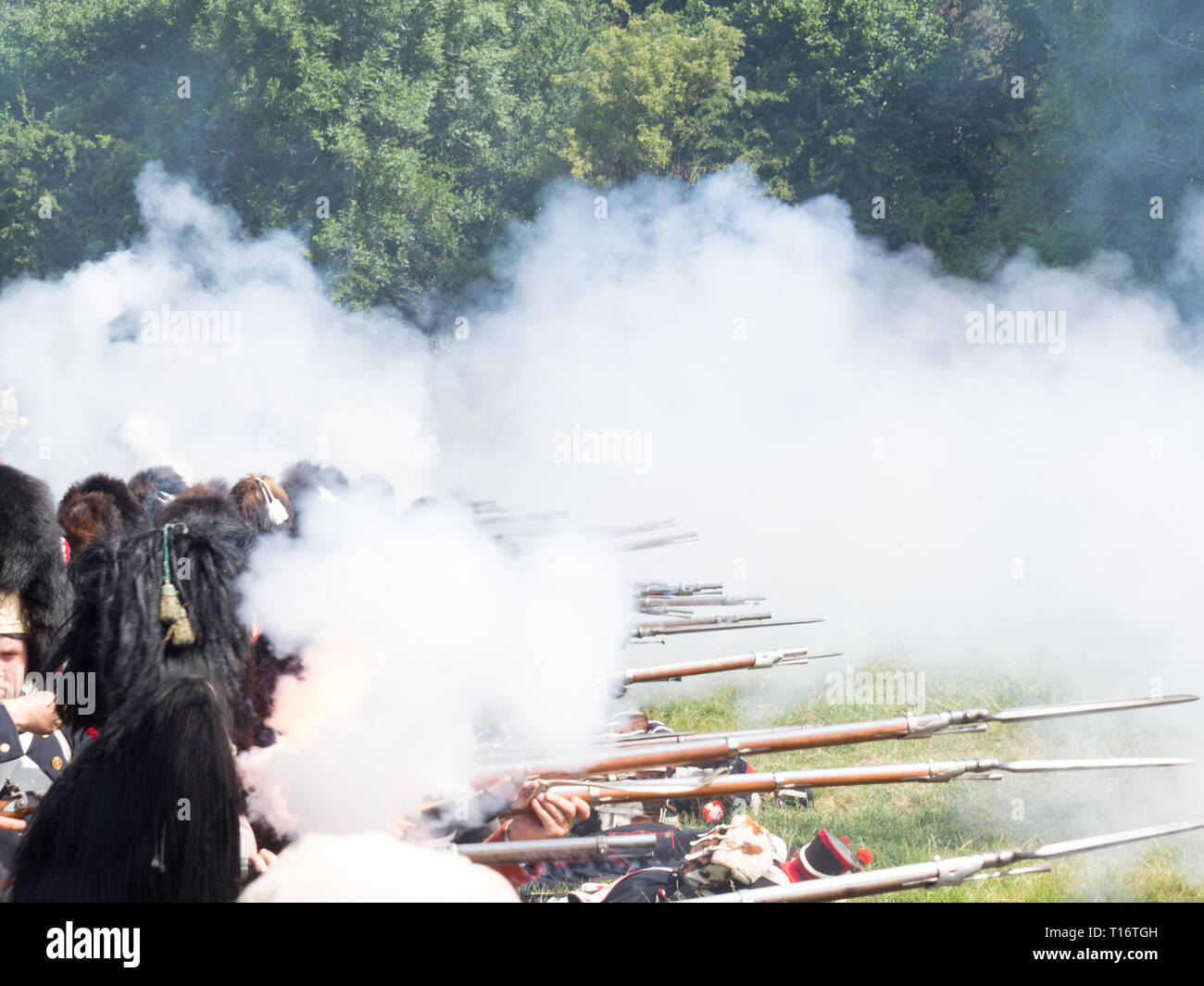Waterloo, Belgium - June 18 2017: French soldiers of the imperial guard firing their muskets. - Stock Image