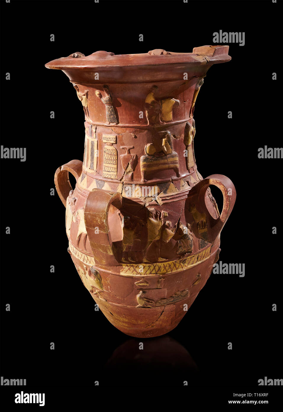 Inandik Hittite relief decorated cult libation vase with four decorative friezes featuring figures coloured in cream, red and black. In the top regist Stock Photo