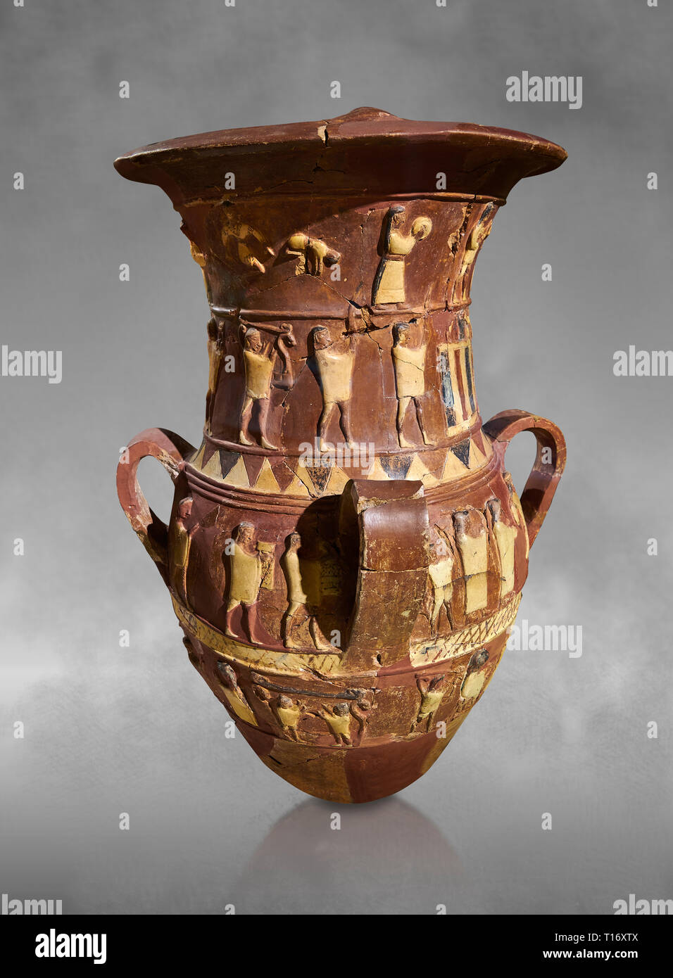 Inandik Hittite relief decorated cult libation vase with four decorative friezes featuring figures coloured in cream, red and black. The processional  - Stock Image