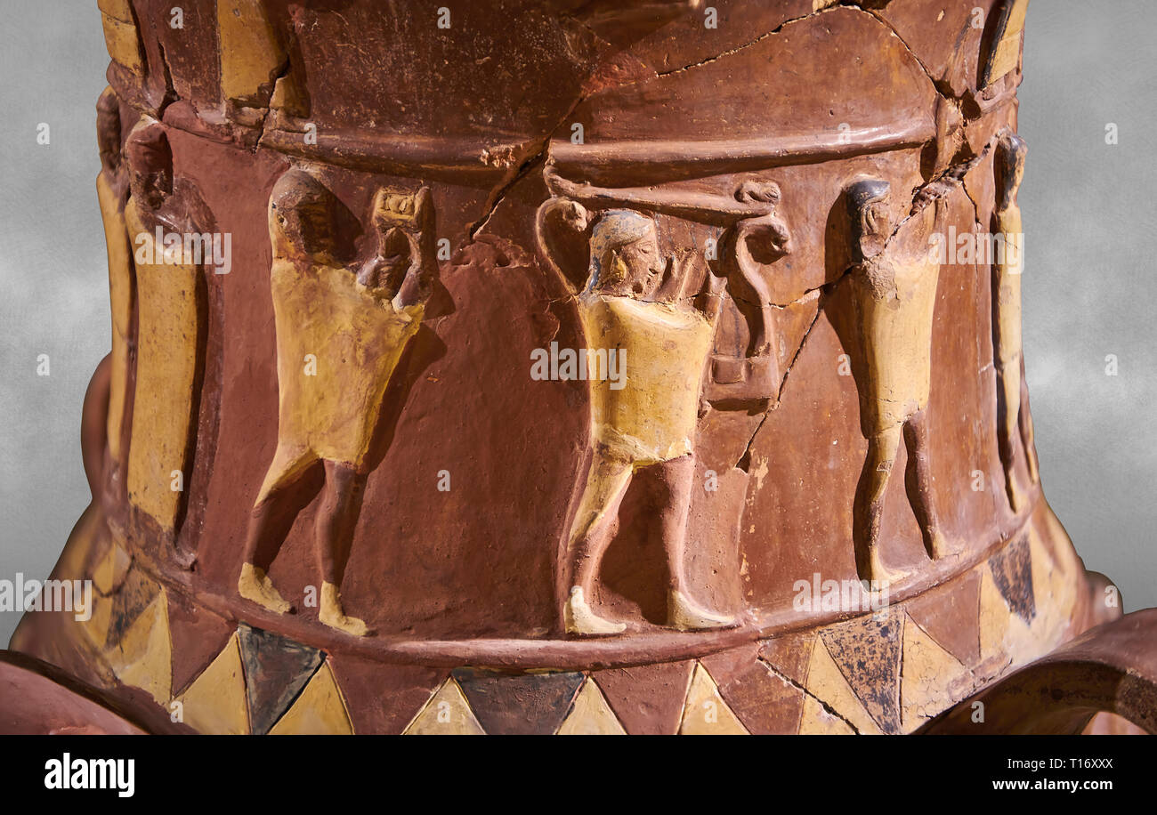Close up of the Inandik Hittite relief decorated cult libation vase decorated with relif figures coloured in cream, red and black. The processional fi Stock Photo