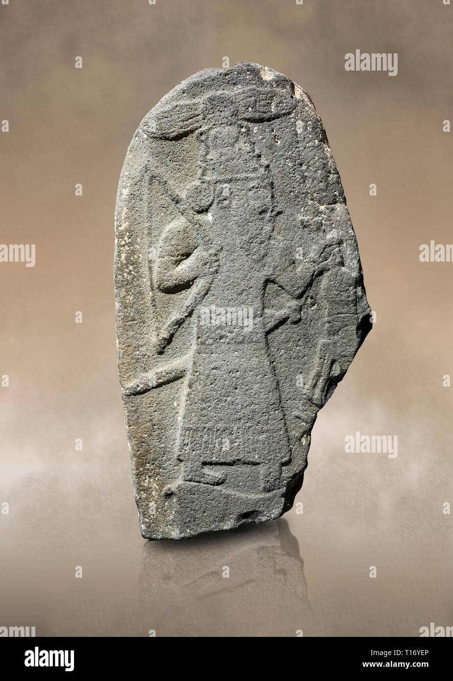 Hittite monumental relief sculpture of a God hunting, its hieroglyphic symbol is above its head. Late Hittite Period - 900-700 BC. Adana Archaeology M Stock Photo