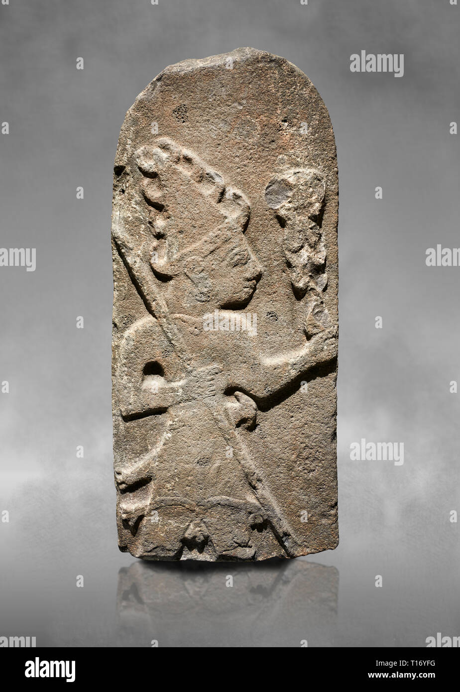 Hittite monumental relief sculpture ofa God probably holding lightning rods. Late Hittite Period - 900-700 BC. Adana Archaeology Museum, Turkey. Again Stock Photo