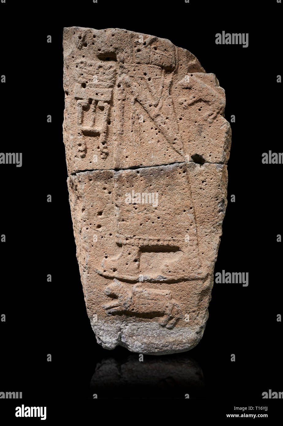 Hittite monumental relief sculpture fragment. Late Hittite Period - 900-700 BC. Adana Archaeology Museum, Turkey. Against a black background Stock Photo