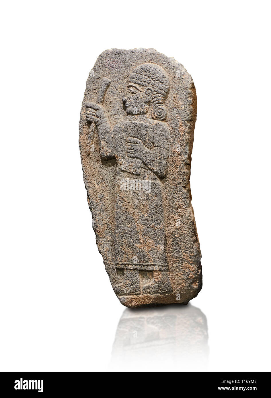 Hittite monumental relief sculpture of a figure holding a document. Adana Archaeology Museum, Turkey. Against a white background Stock Photo