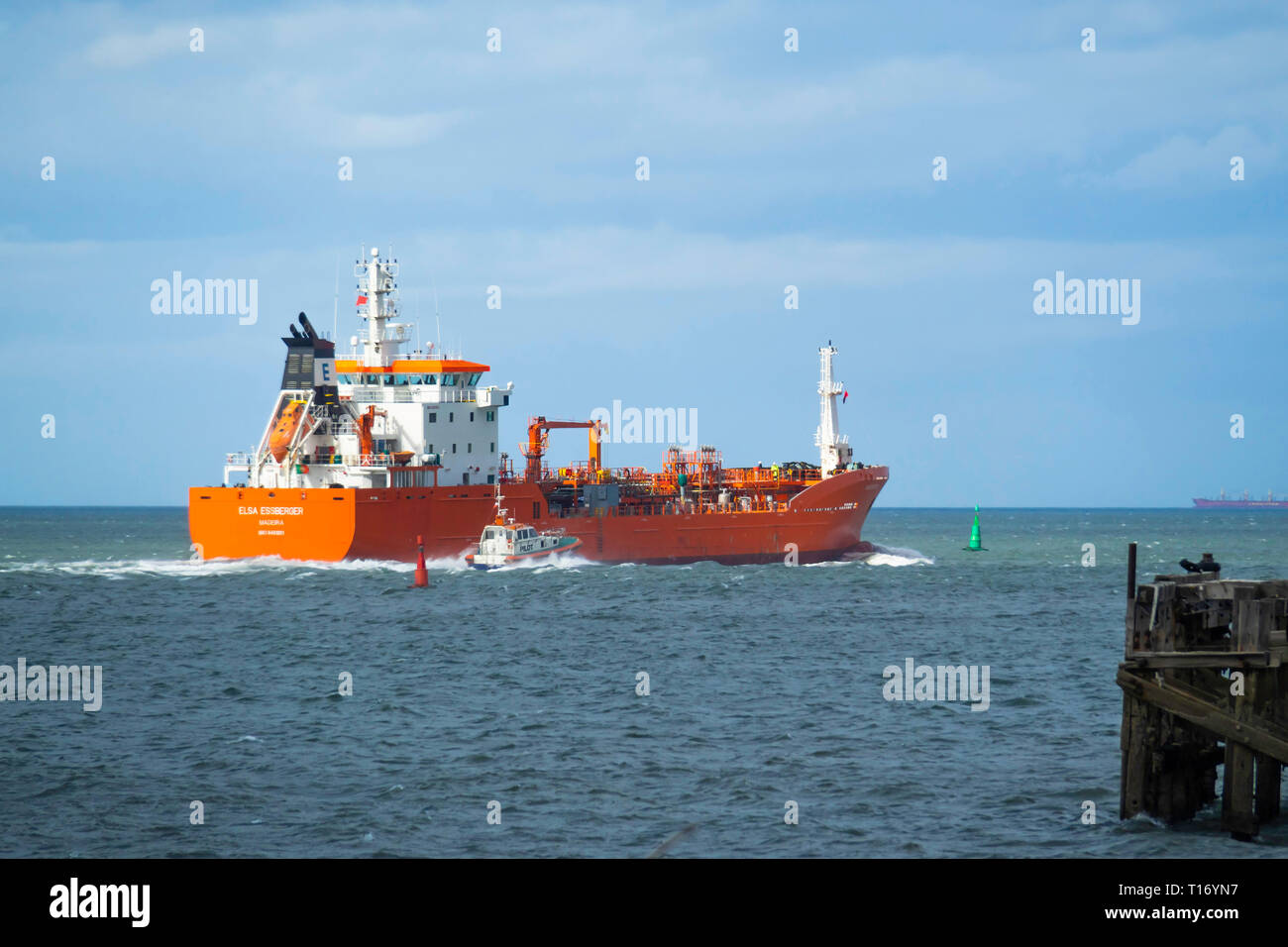 Oil Chemical tanker ELSA ESSBERGER  IMO:9481001, MMSI 255805470 departing from Teesport England UK with a pilot boat alongside Stock Photo