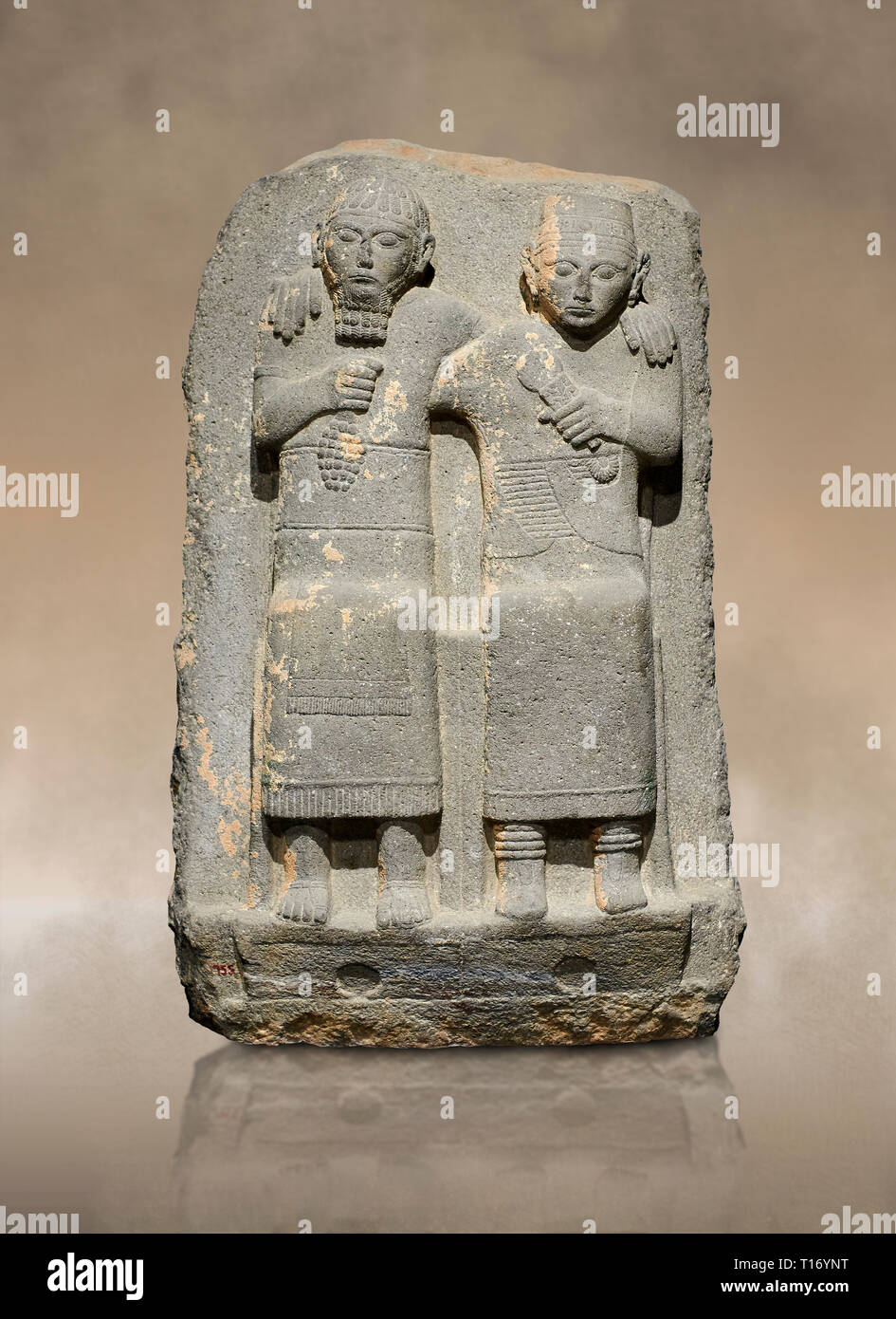 Hittite monumental relief sculpture of of two seated figure, not a typical Hittite style with a lot of other influences. Late Hittite Period - 900-700 Stock Photo