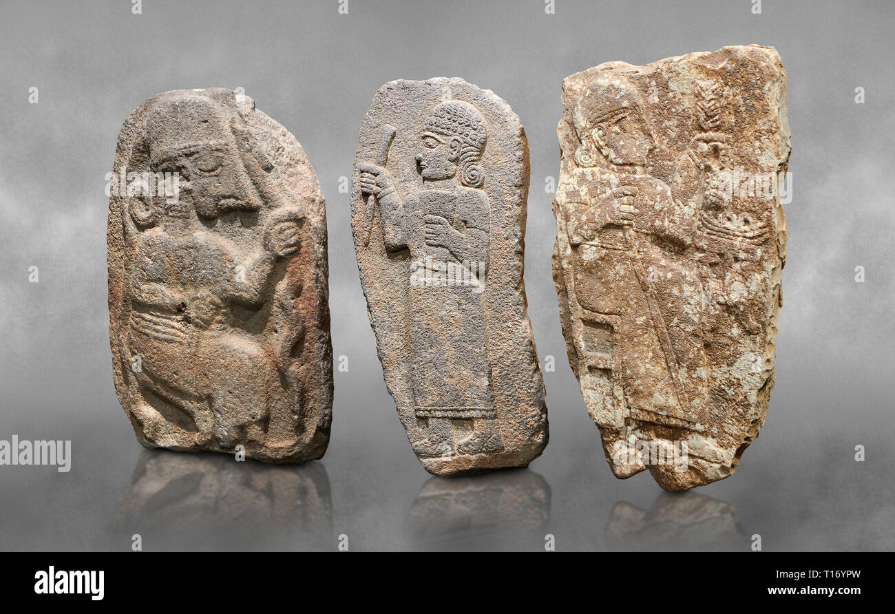 Hittite monumental relief sculptures, 900 - 700 BC, from Adana Archaeology Museum, Turkey. Against a grey art background Stock Photo
