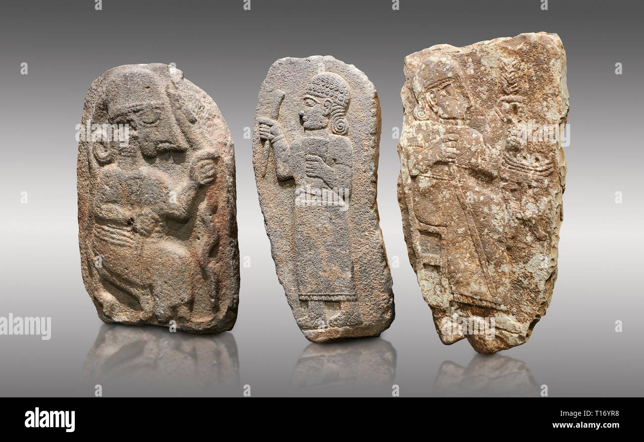 Hittite monumental relief sculptures, 900 - 700 BC, from Adana Archaeology Museum, Turkey. Against a grey background Stock Photo