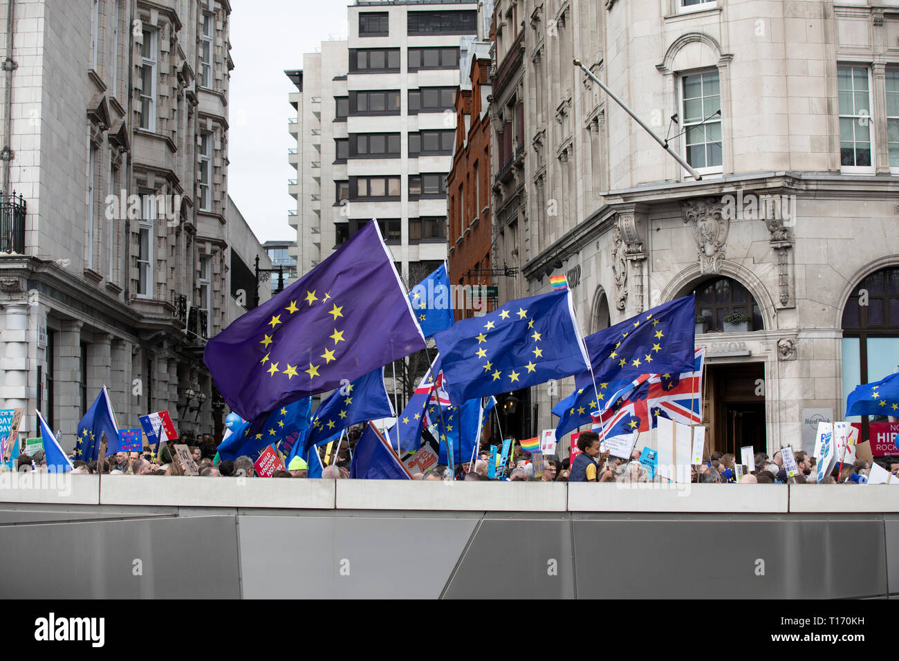 European Union flags above marchers, People's Vote March, London, England - Stock Image