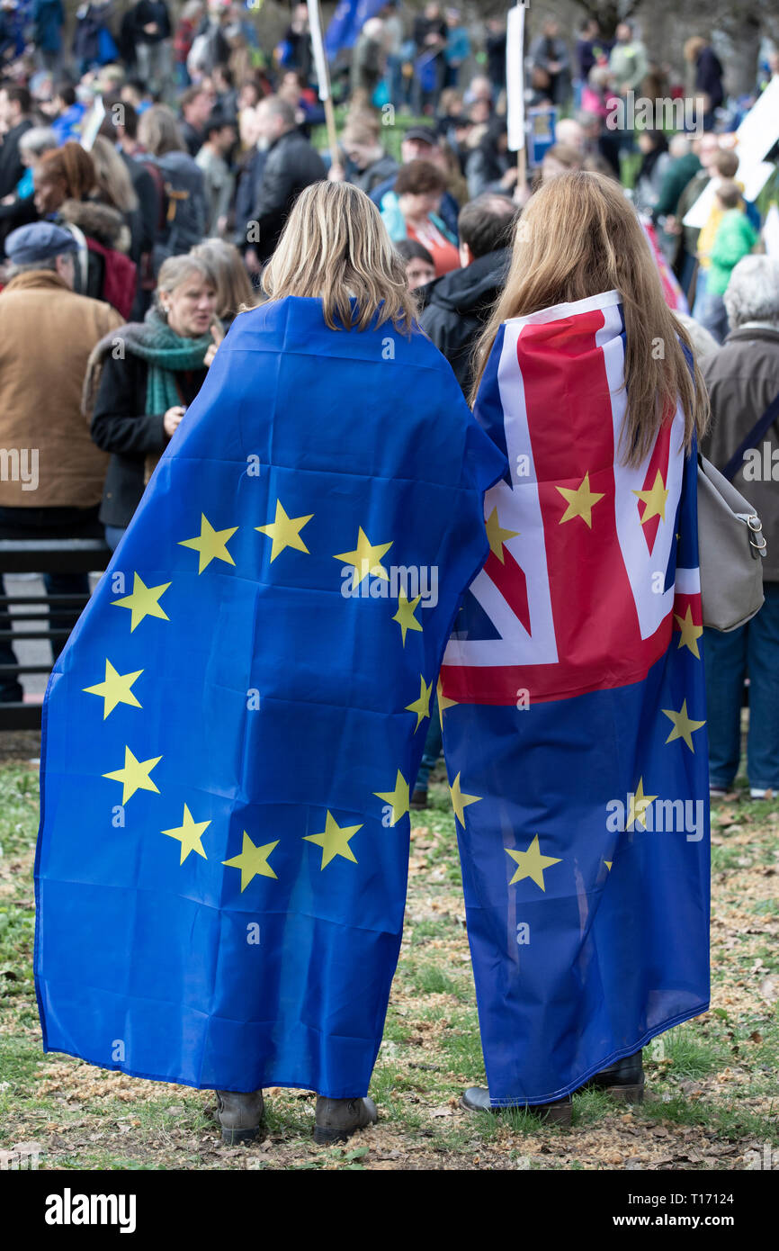 Two female protestors wearing flags, People's Vote March, London, England Stock Photo