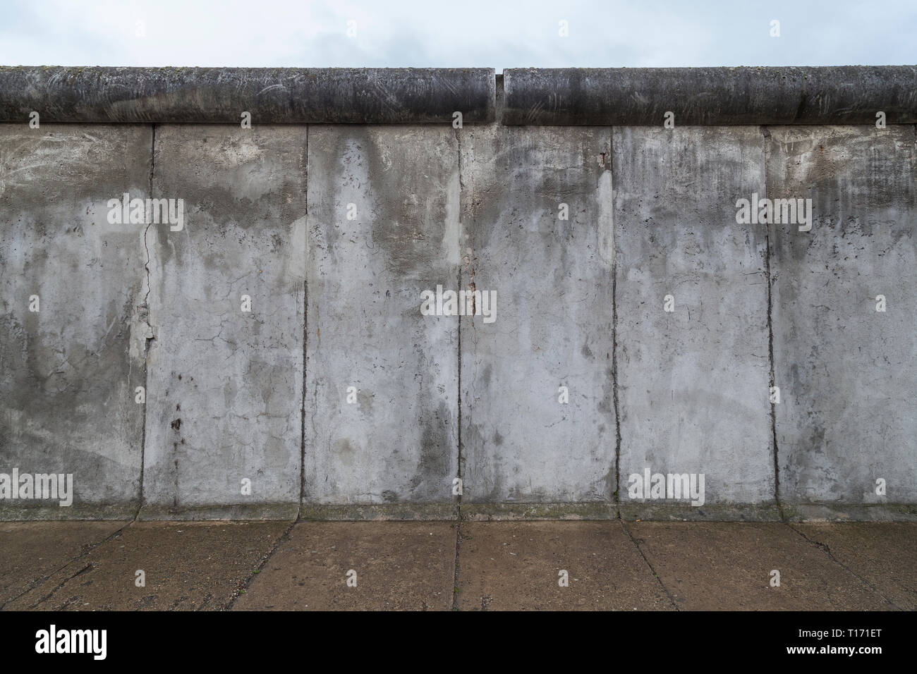 Front view of a section of the original Berlin Wall at the Berlin Wall Memorial (Berliner Mauer) in Berlin, Germany, on a cloudy day. Stock Photo