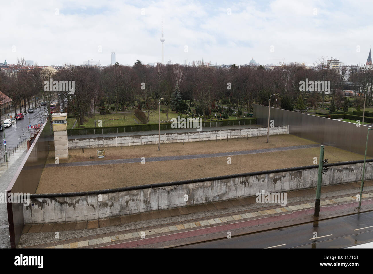 Remains of the Berlin Wall and watchtower at the Berlin Wall Memorial (Berliner Mauer) on Bernauer Straße in Berlin, Germany, viewed from above. - Stock Image