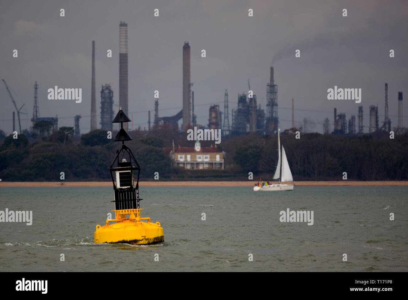 bouy,cardinal,mark,navigation,yacht,sailing,past,Fawley,Oil,Refinery,The Solent,Cowes,Isle of Wight, England,UK, - Stock Image