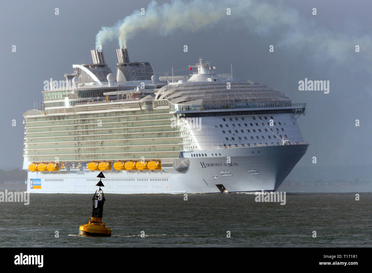 huge,massive,Pollution, Harmony of the Sea, Cruise Liner, ship, Cowes, Isle of Wight, The Solent,leaving,Southampton,Port,Terminal,England, UK, - Stock Image