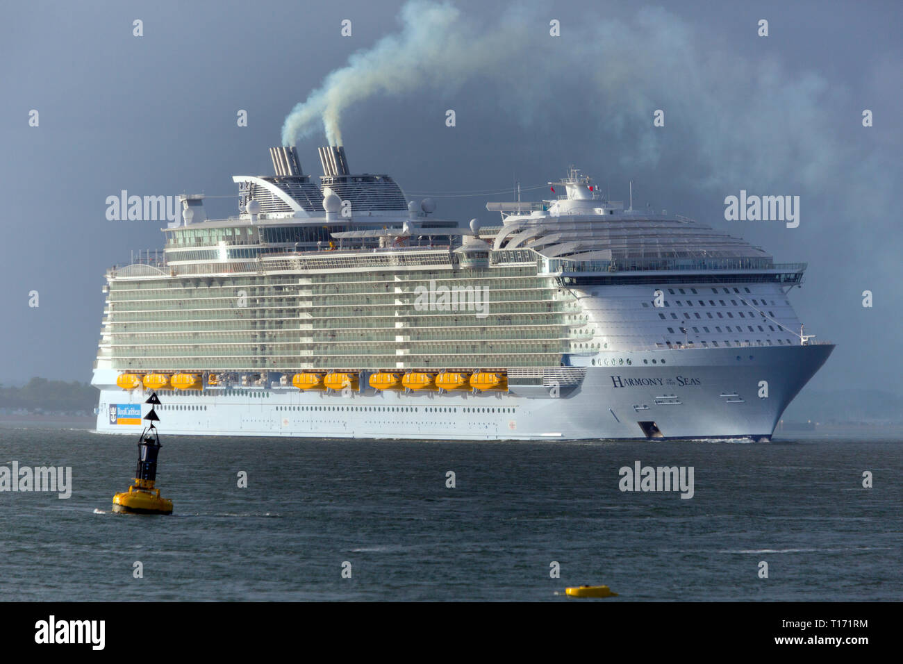 huge,massive,Pollution,Harmony of the Sea, Cruise Liner, ship, Cowes, Isle of Wight, The Solent,leaving,Southampton,Port,Terminal,England, UK, - Stock Image