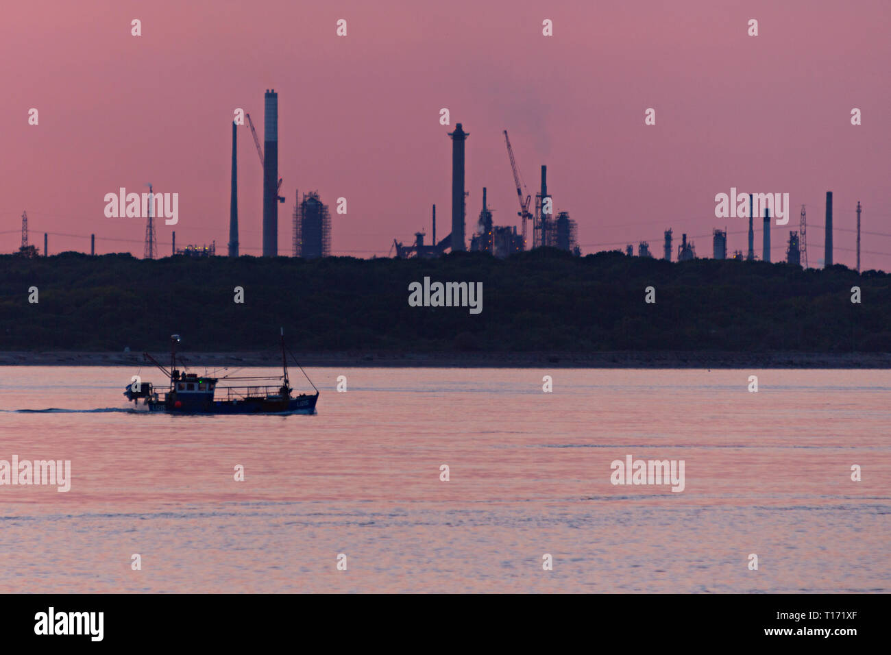 Fawley,Oil,Refinery,pollution,Fishing,boat,lobsters,crabs,oysters,pots,long,line,trawler,sunset,sunrise,The Solent,Cowes,Isle of Wight,England,UK, - Stock Image