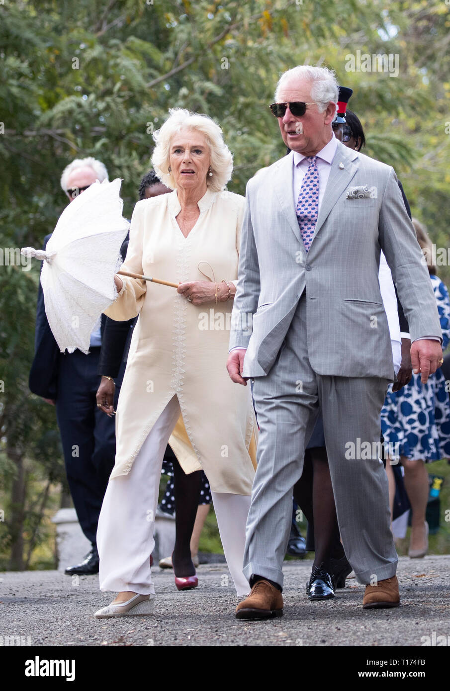 The Prince of Wales and the Duchess of Cornwall after the Official Welcome Ceremony and Reception with the Prime Minister Dr. Keith Mitchell at the Grenada Houses of Parliament Building during a one day visit to the Caribbean island of Grenada. - Stock Image
