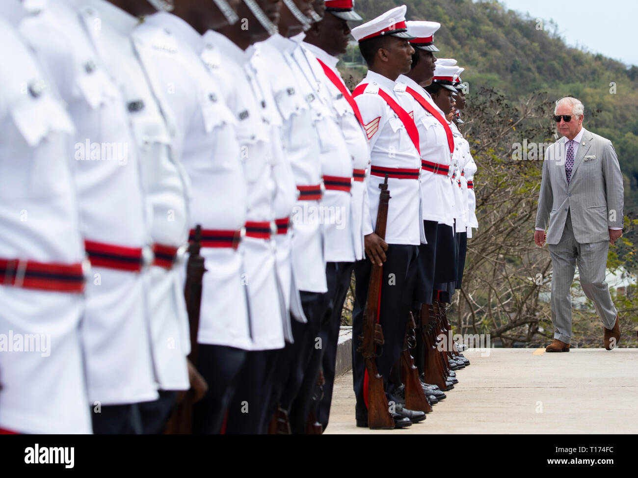The Prince of Wales inspects the troops during the Official Welcome Ceremony and Reception with the Prime Minister Dr. Keith Mitchell at the Grenada Houses of Parliament Building during a one day visit to the Caribbean island of Grenada. - Stock Image