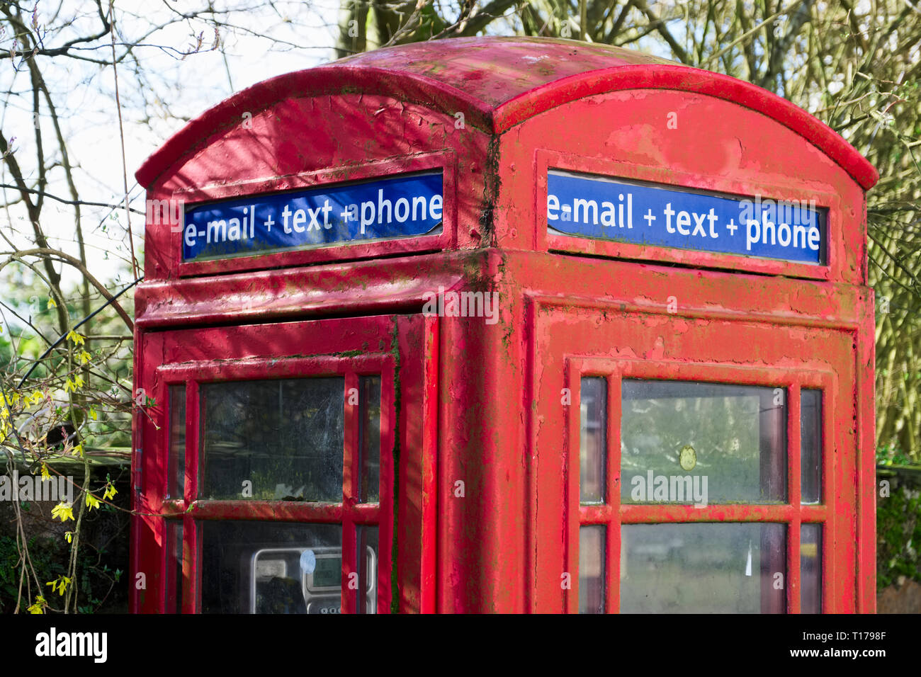 Red telephone booth box for email text and phone retro communication - Stock Image