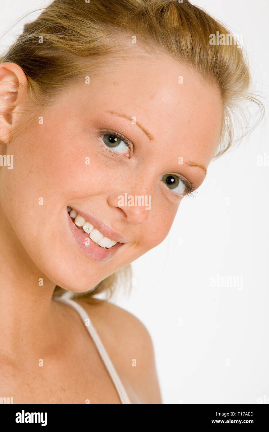 Portrait of a young woman laughing merrily into the camera - Stock Image