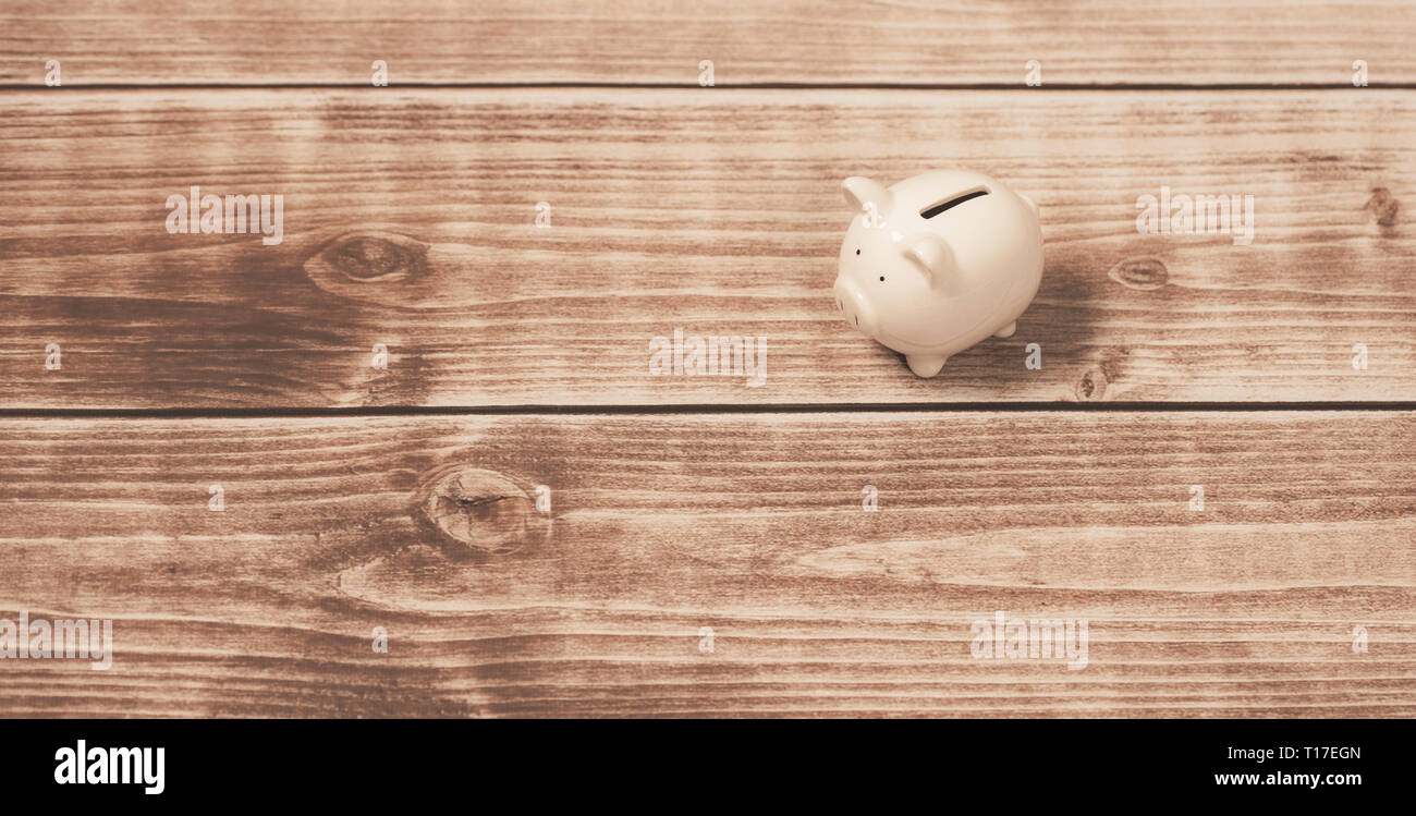 white piggy bank on wooden background.Investment concept - Stock Image