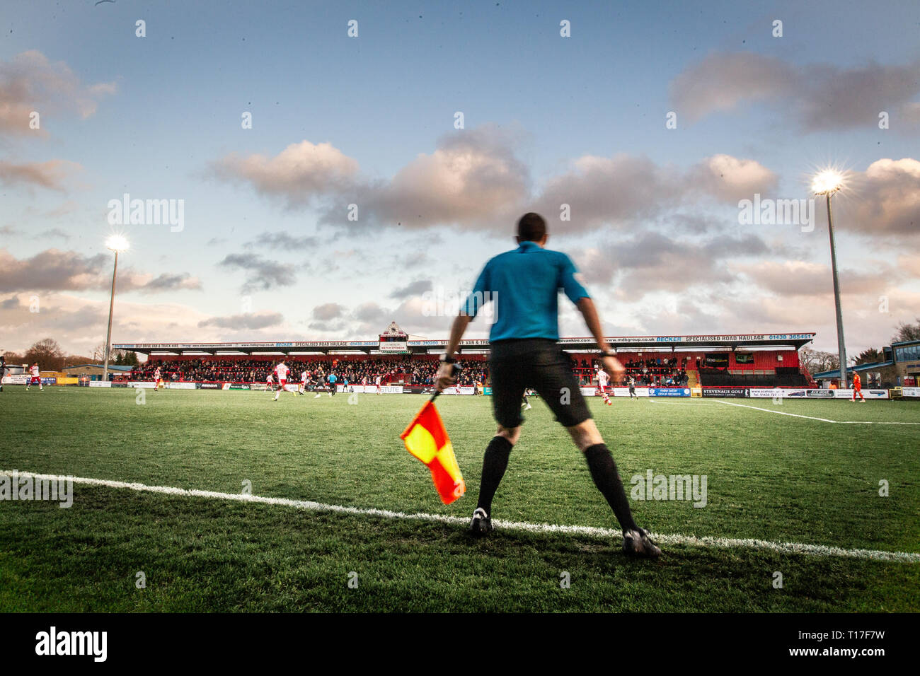 assistant referee running the line during football match - Stock Image