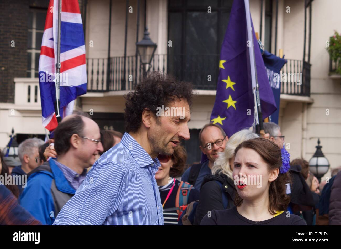 Older man speaking with younger woman at the anti-Brexit march in London on 23 March 2019 - Stock Image