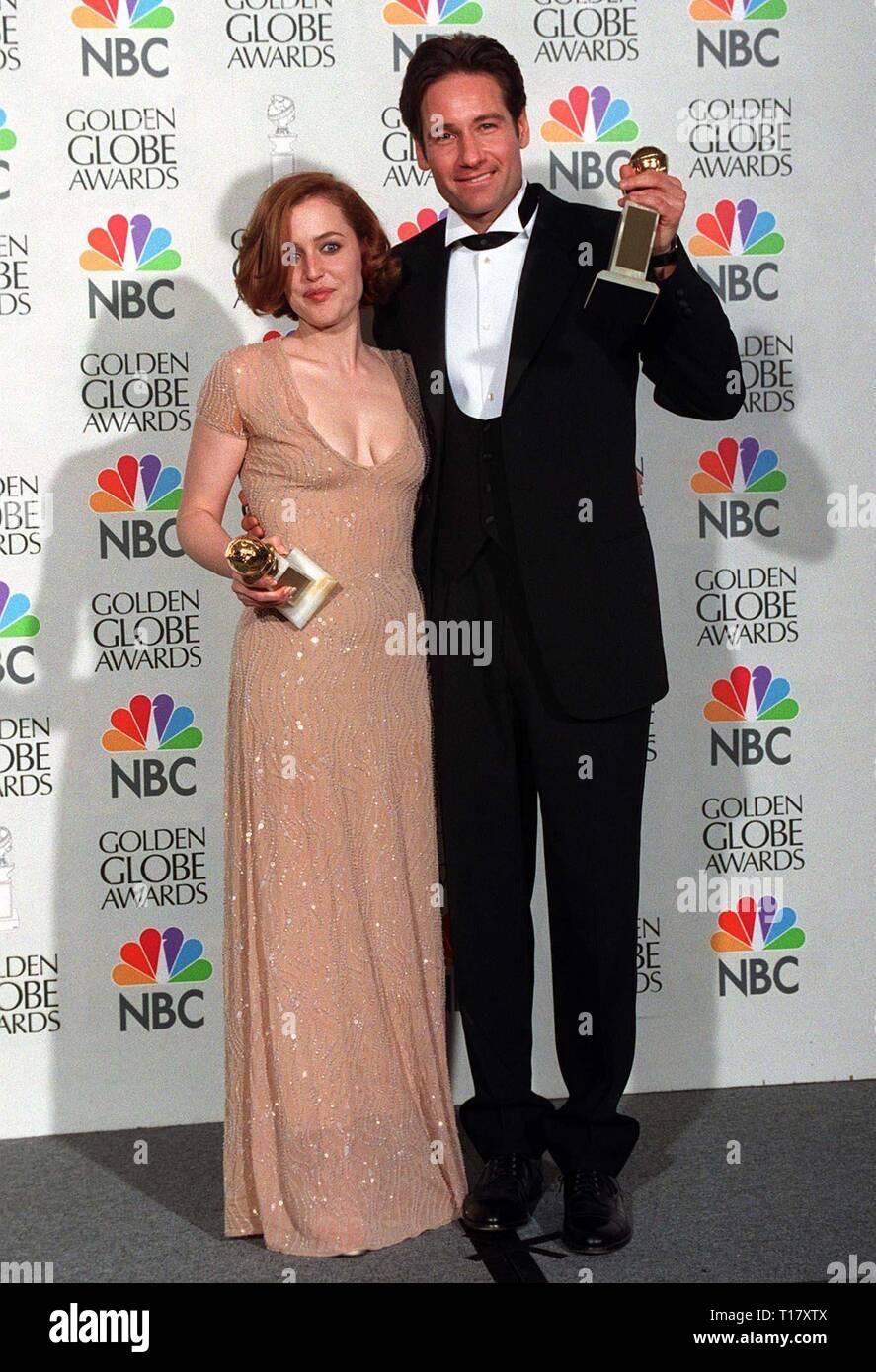 LOS ANGELES, CA. January 19, 1997: 'X-Files' stars David Duchovny & Gillian Anderson at the Golden Globe Awards. - Stock Image