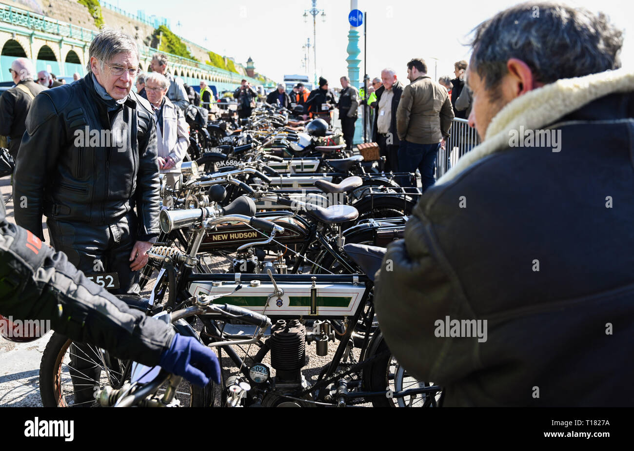 Brighton, UK. 24th March 2019. Visitors enjoy the 80th Anniversary Pioneer Run for pre 2015 veteran motorcycles in Brighton . The run organised by the Sunbeam Motor Cycle Club begins on the Epsom Downs in Surrey and finishes on Madeira Drive on Brighton seafront Credit: Simon Dack/Alamy Live News Stock Photo