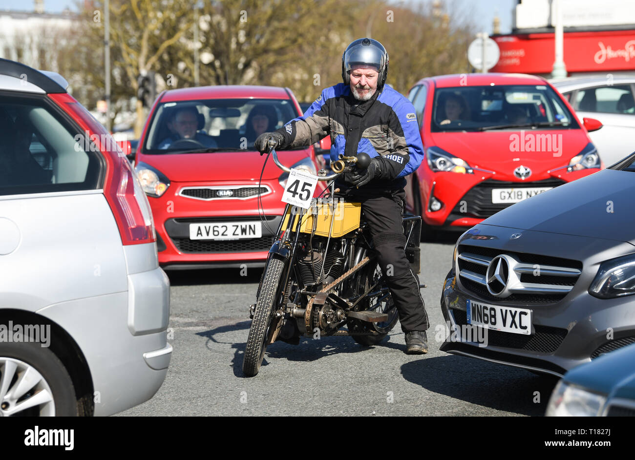 Brighton, UK. 24th March 2019. John Moore on his 1908 BAT weaves through the traffic as he nears the finish of the 80th Anniversary Pioneer Run for pre 2015 veteran motorcycles in Brighton. The run organised by the Sunbeam Motor Cycle Club begins on the Epsom Downs in Surrey and finishes on Madeira Drive on Brighton seafront Credit: Simon Dack/Alamy Live News Stock Photo