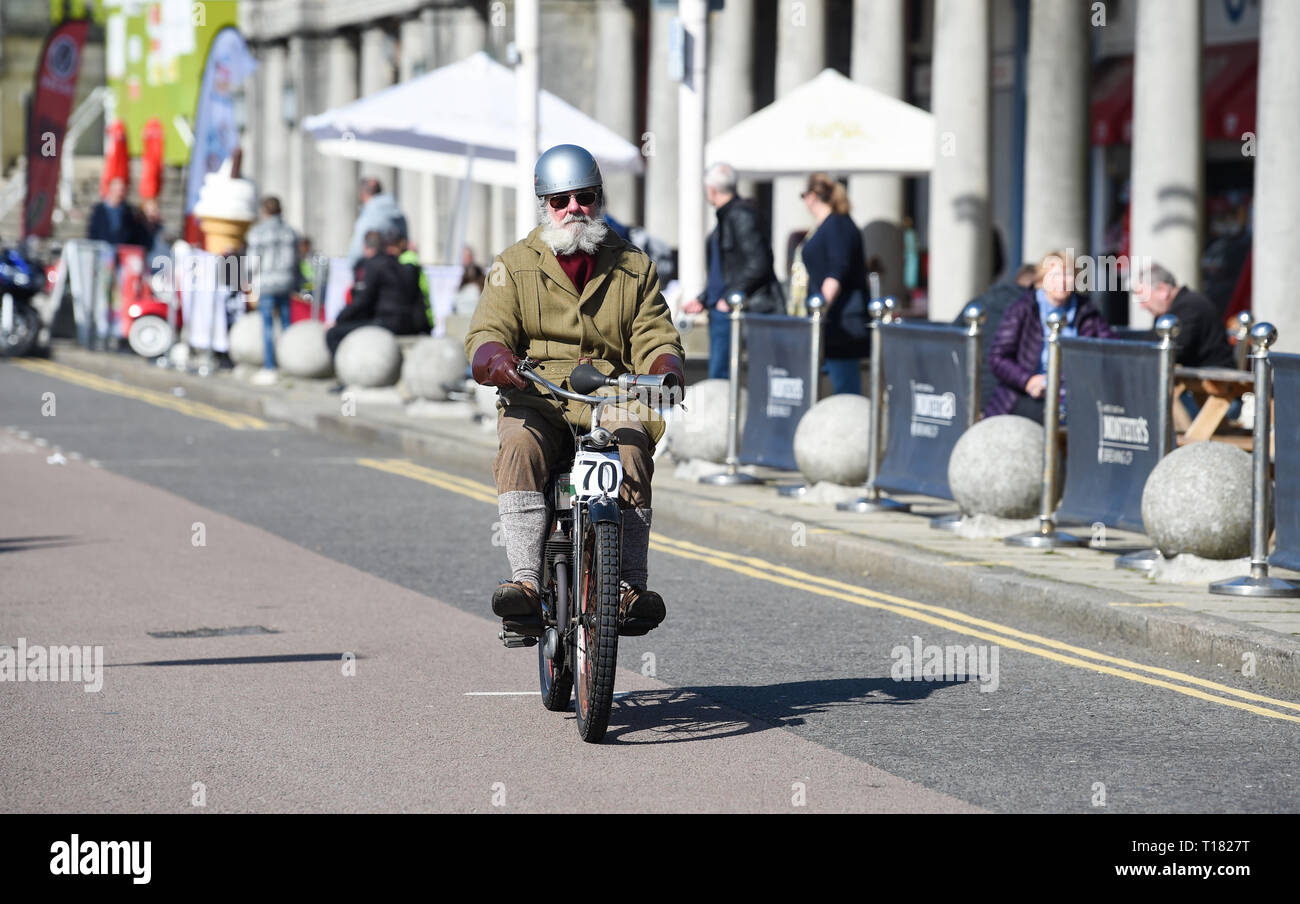 Brighton, UK. 24th March 2019. Mike Lawson on a 1910 Triumph nears the finish of the 80th Anniversary Pioneer Run for pre 2015 veteran motorcycles in Brighton . The run organised by the Sunbeam Motor Cycle Club begins on the Epsom Downs in Surrey and finishes on Madeira Drive on Brighton seafront Credit: Simon Dack/Alamy Live News Stock Photo