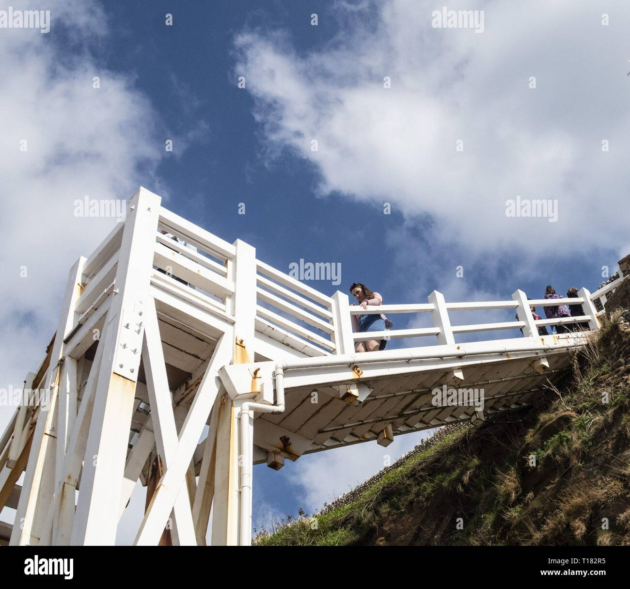 Sidmouth, UK. 24th Mar, 2019. The view from Jacob's Ladder on the beach at Sidmouth proves popular on a sunny day in March. Credit: Photo Central/Alamy Live News Stock Photo