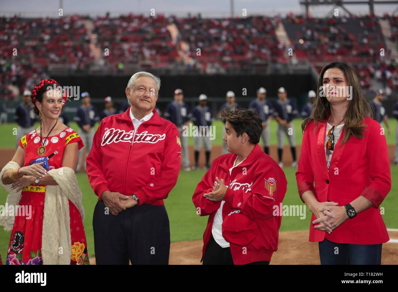 Mexico City, Mexico. 23rd Mar, 2019. Mexican President Andres Manuel Lopez Obrador, 2nd right, during the opening ceremony at the Alfredo Harp Helu Baseball Stadium, home of the Mexico City Red Devils March 23, 2019 in Mexico City, Mexico. Obrador who has enjoyed soaring approval ratings was booed and jeered by the hostile crowd in a rare display of public animosity for the popular president. Credit: Planetpix/Alamy Live News - Stock Image