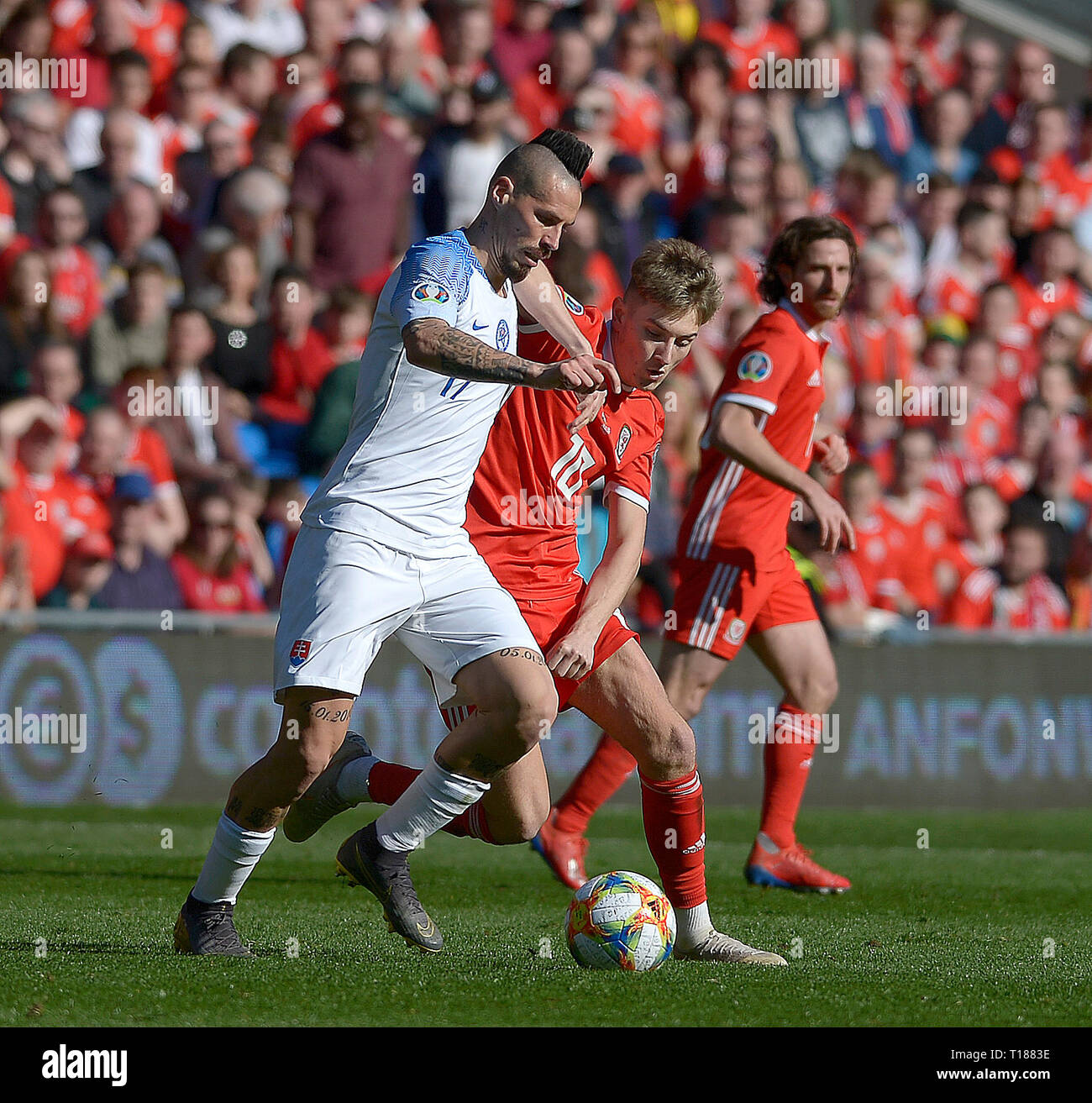 Cardiff, Wales, UK. 24th Mar 2019. Football, UEFA European Qualifiers Group E, Wales v Slovakia, 24/03/19, Cardiff City Stadium, K.O 2PM  Wales' David Brooks challenges Slovakia's Marek Hamsik  Andrew Dowling Credit: Andrew Dowling/Influential Photography/Alamy Live News Stock Photo