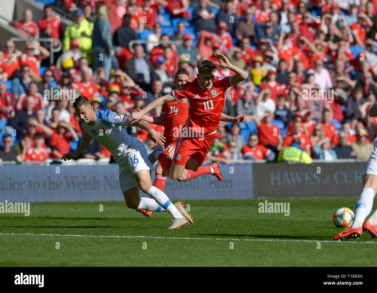 Cardiff, Wales, UK. 24th Mar 2019. Football, UEFA European Qualifiers Group E, Wales v Slovakia, 24/03/19, Cardiff City Stadium, K.O 2PM  Wales' David Brooks get fouled by Slovakia's David Hancko  Andrew Dowling Credit: Andrew Dowling/Influential Photography/Alamy Live News Stock Photo