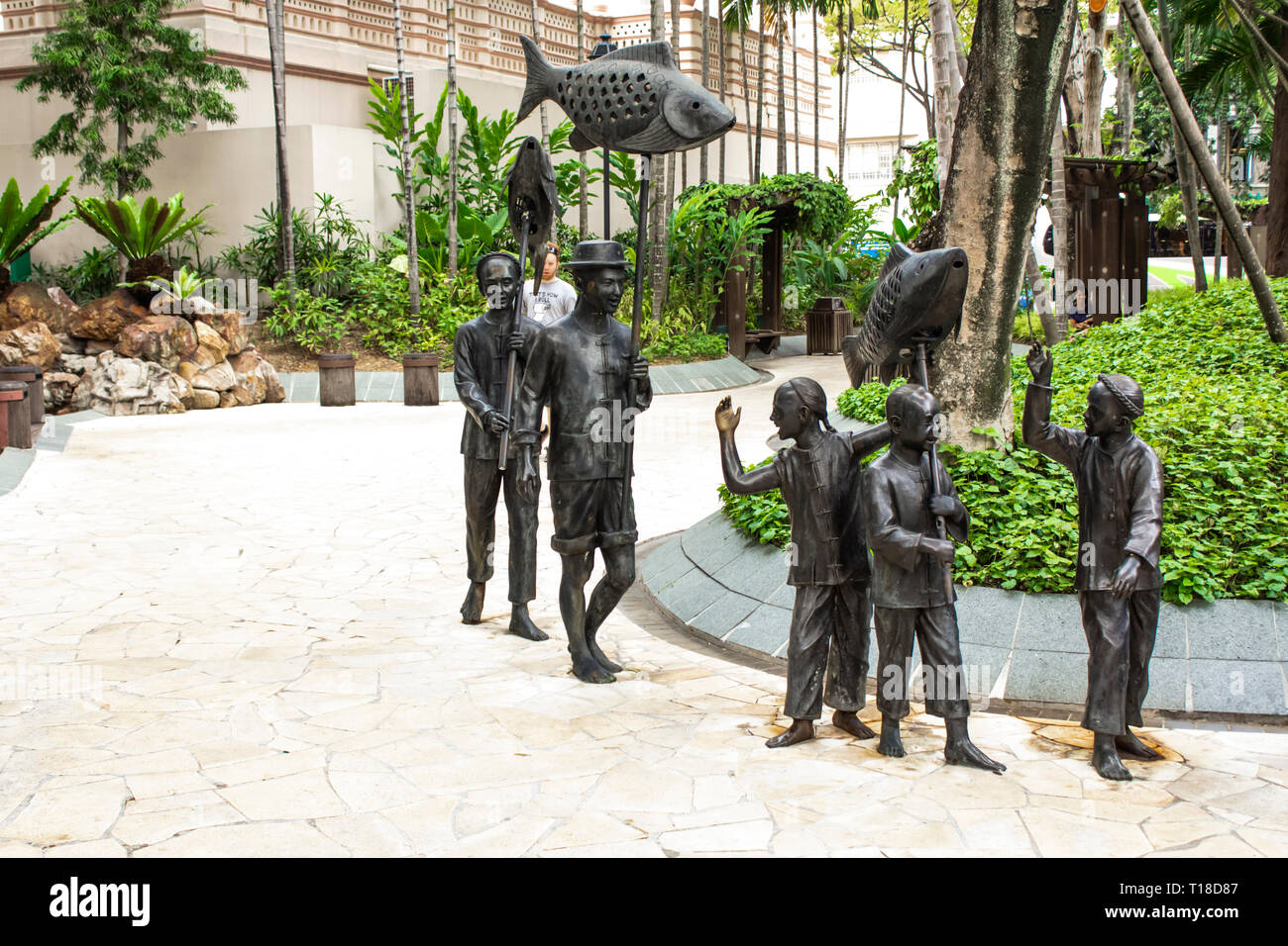 SINGAPORE - AUGUST 4, 2014: Chinese Procession sculpture at Telok Ayer Green Park in Singapore. Sculpture represents the celebratory procession of Chi - Stock Image