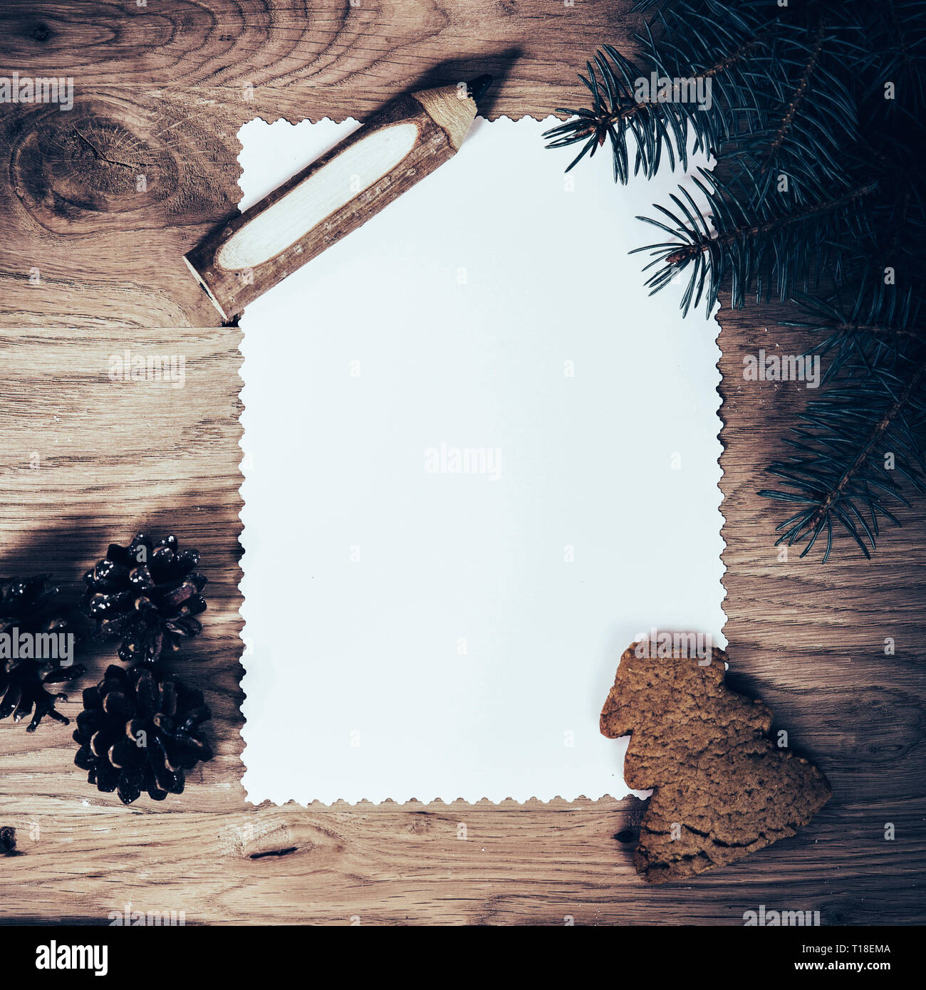 blank sheet of paper on the wooden floor with a pencil Stock Photo